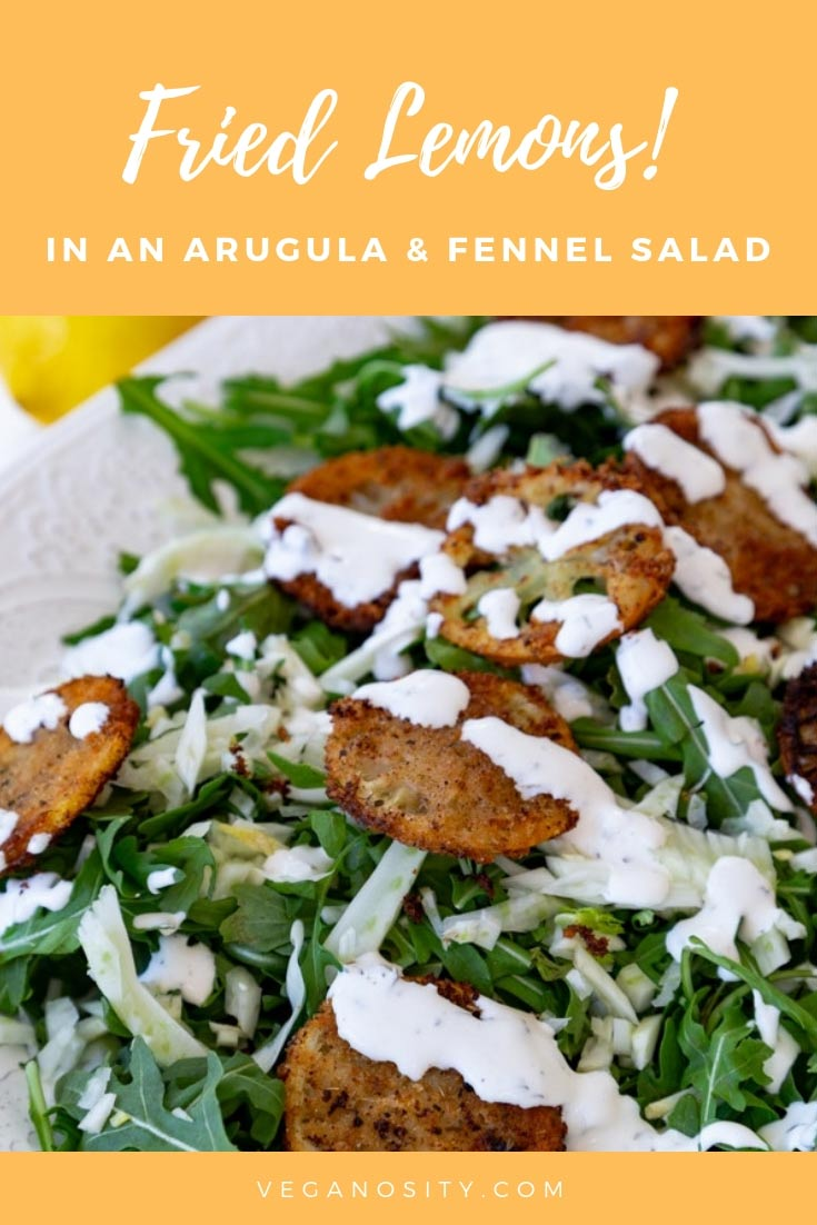 An arugula and fennel salad with creamy lemon dressing, topped with delicious fried lemons! #vegan #friedlemons #salad