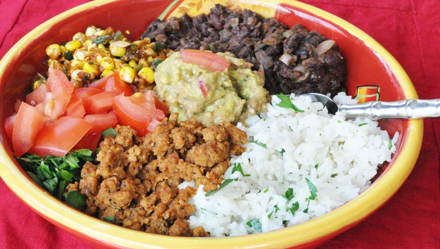 Vegan Burrito Bowl! This is better than anything you'll get in a fast food restaurant. It's fresh, homemade, healthy, and delicious. Go to www.veganosity.com to get the recipe.
