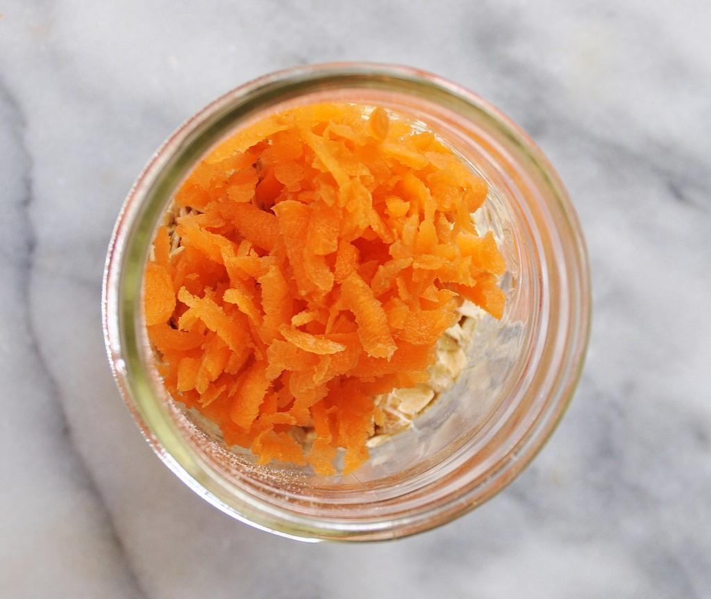 Grated Carrots in a jar on a marble surface