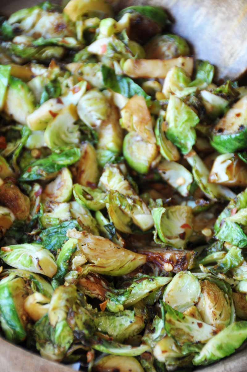 Spicy Stir-Fried Brussels Sprouts! This crisp, spicy, slightly sweet and tangy Brussels sprouts recipe will become on of your favorites. Perfect for your holiday meal! www.veganosity.com