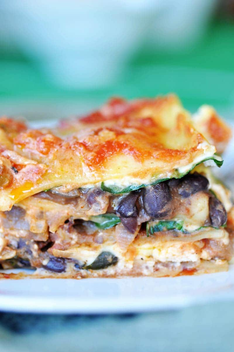 Vegan Mexican Lasagna! #KickUpTheFlavor with Pace Picante Sauce. This lasagna recipe is filled with spicy Mexican ingredients that are perfect for game day or any party with a hungry crowd. www.veganosity.com #ad