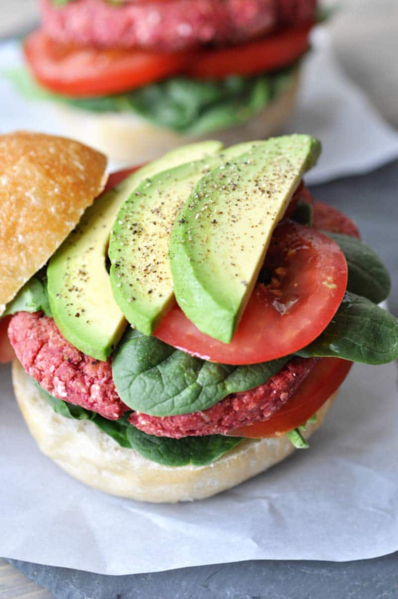 Vegan Beet Burgers that Won't Fall Apart on the Grill! This veggie burger recipe is made with aquafaba. It;s the perfect binder, and it holds the burger together like nothing else does. www.veganosity.com