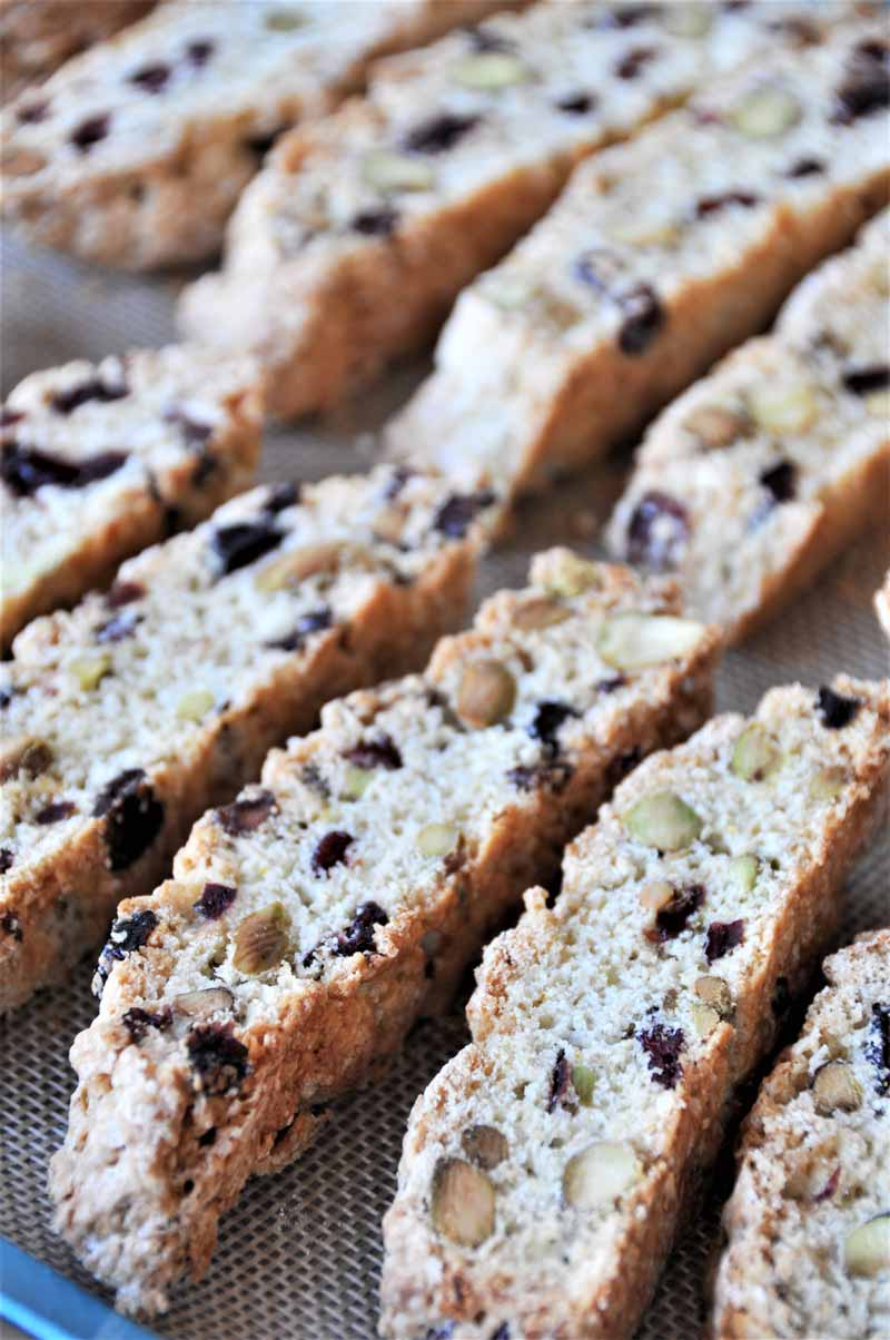 Cranberry biscotti cooling on a baking sheet.