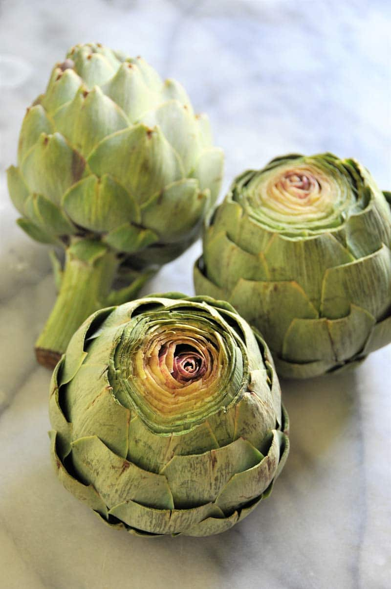 Learn how to properly steam artichokes and make a spicy mayo for dipping.