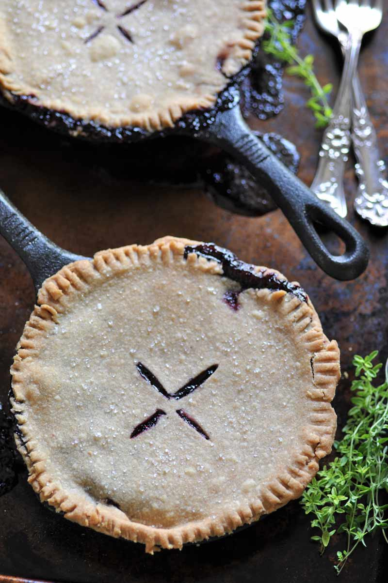 Blueberry Thyme Pie that's made in an iron skillet! An easy and delicious dessert.