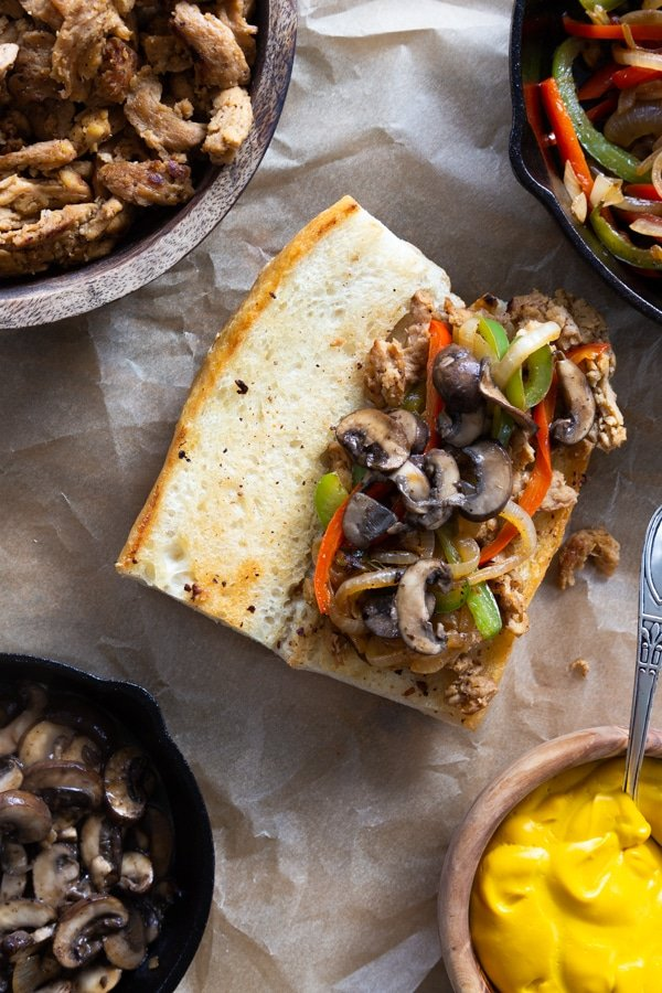 Building a philly cheesesteak process shot with bell peppers, onions, mushrooms, and soy curls