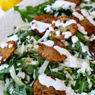 Delicious and delicate fried lemons in an arugula and fennel salad with a creamy lemon dressing! Totally vegan! #vegan #salad #friedlemons